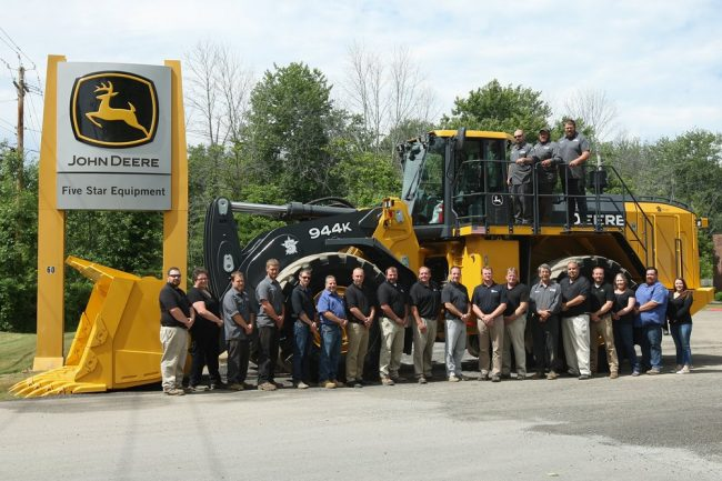 The Rochester branch employees with and on Five Star Equipment's first 944K Hybrid Wheel Loader.